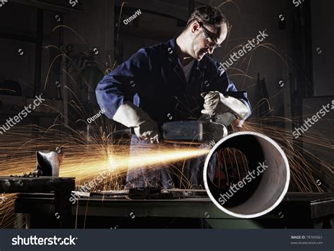 worker cutting steel pipe using metal stock photo 380191102 heavy industry worker cutting steel pipe with angle grinder in workshop stock photo 78769561