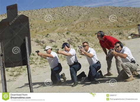 people firing guns  shooting range royalty