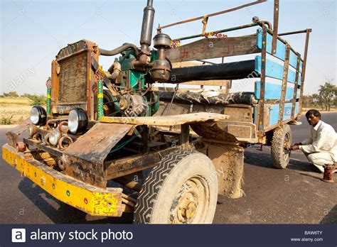 indian made cars man with home made car rajasthan india stock photo