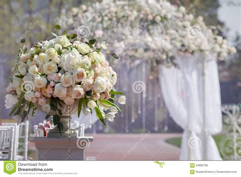 Wedding Arch Vases by Beautiful Bouquet Of Roses In A Vase On A Background Of A
