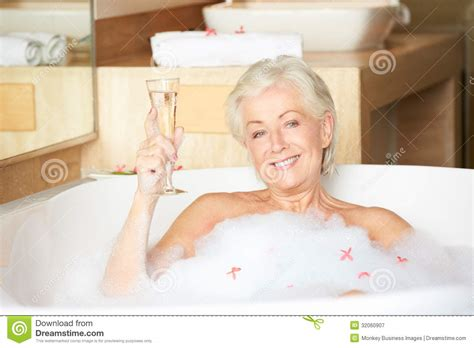 Senior Bathtub by Senior Relaxing In Bath Chagne Royalty