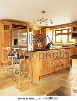 central island unit breakfast bar in modern country style metal stools at breakfast bar on island unit in modern