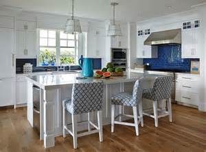 Blue Kitchen Backsplash white and blue beach cottage kitchen features white cabinets paired