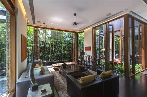 define livingroom lush gardens and peekaboo roof pool define contemporary