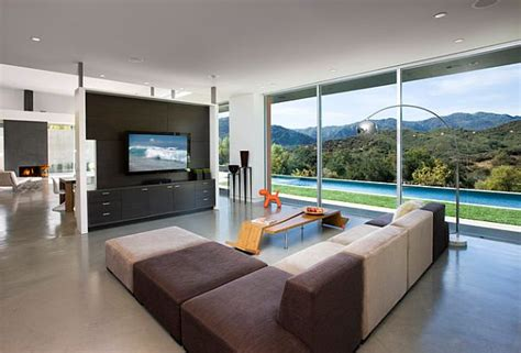 where to put tv in living room with lots of windows how to incorporate your tv into your home decor
