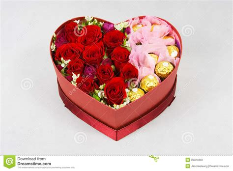 Table Floral Arrangements by Heart Shaped Box Of Flowers Stock Photo Image 39324859