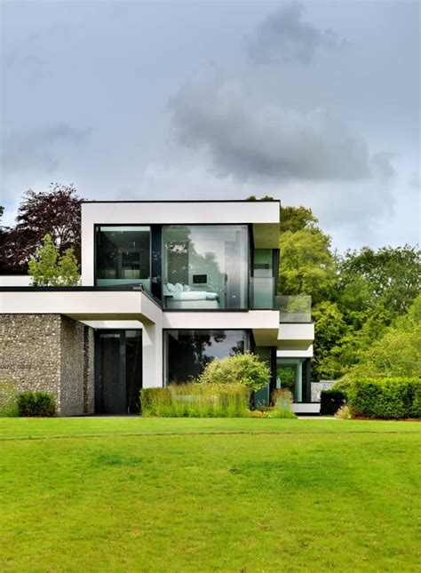 a modern country house on the banks of the river thames by