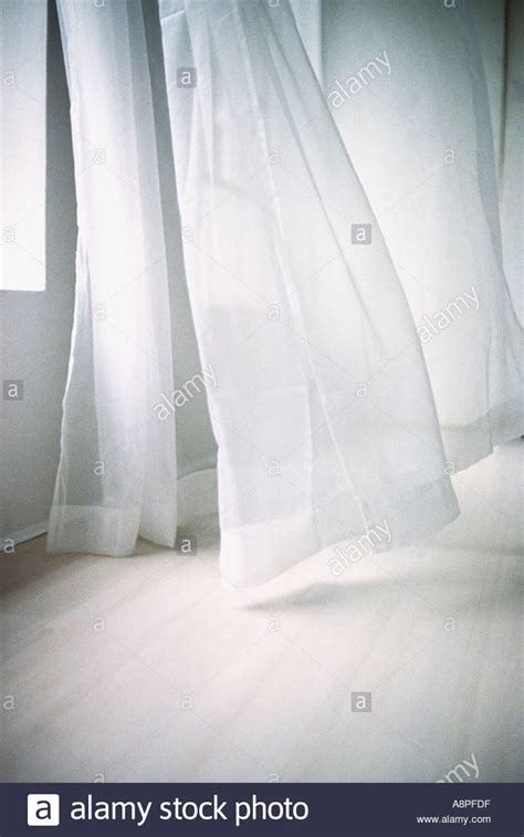 blowing curtains blowing white curtain stock photo royalty free image