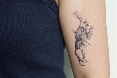 white rabbit tattoo white rabbit arm tattoomagz