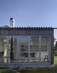 Small Cabin Plans With Porch small swedish house made from boards and corrugated metal