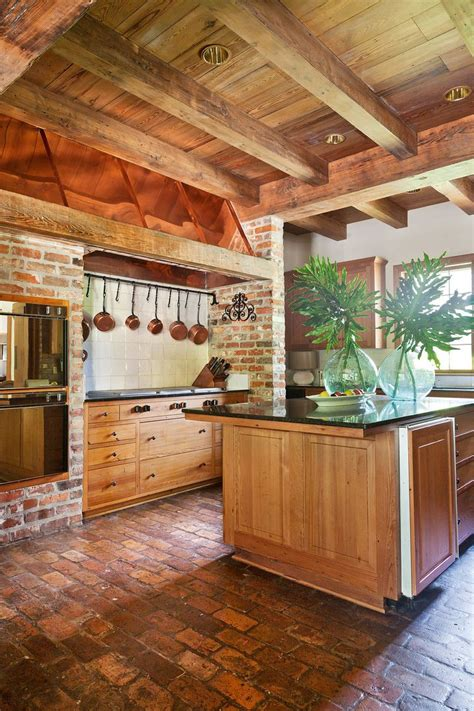 brick floor reclaimed wood beams cabinets dining