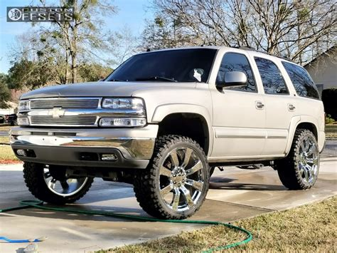 chevrolet tahoe wheel replicas  rough country suspension lift  custom offsets