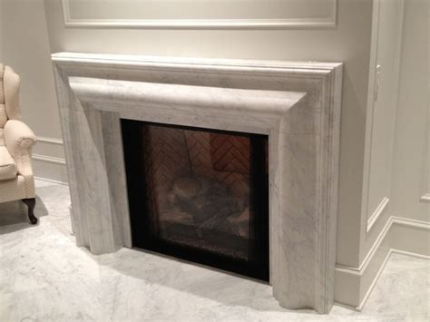 white marble fireplace surrounds contemporary indoor