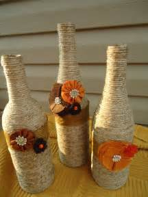 Decorative wine bottles wrapped with twine and fabric flowers set of