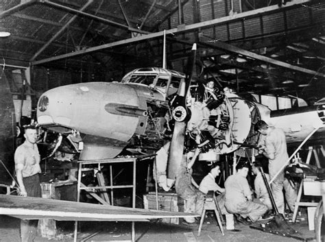 Aircraft Mechanic Description by File Statelibqld 1 88816 Aircraft Mechanics Working On An Avro Anson Mk1 Plane Archerfield Ca