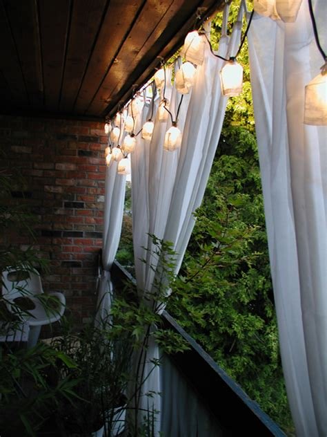 Outdoor Curtains For Balcony For Balcony Privacy Try Hanging A Simple Curtain And Illuminating It With A Pretty