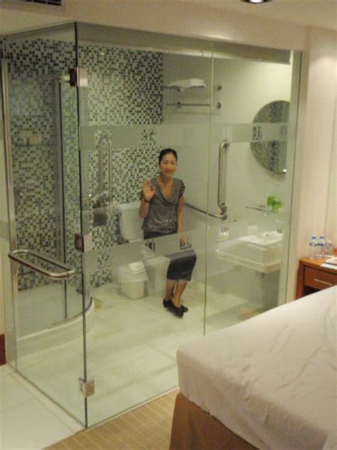 the bathroom with a glass wall with a view to the bedroom our quirky hotel room complete with bathroom with glass