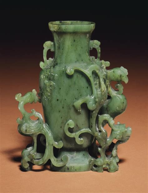 a small spinach green jade vase 18th 19th century