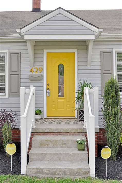 Grey House Yellow Door by Grey House Grey Shutters Yellow Door Exterior