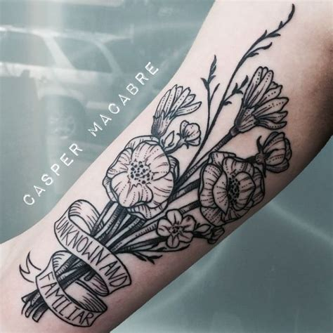 traditional flower bouquet tattoo looks like it s got a