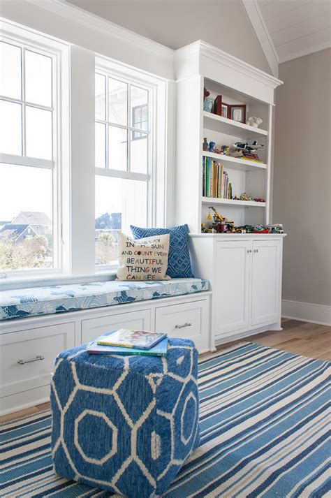 window seat flanked by bookcases new house with coastal interiors home bunch
