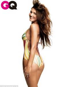 Margherita missoni is as eye catching as her swimsuit as she poses for