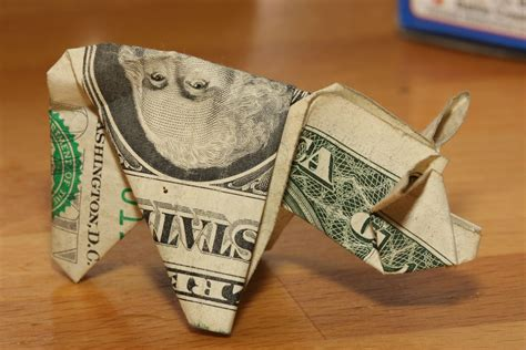 Dollar Origami Pig - motorist s dollar bill origami pigs photo gallery autoblog