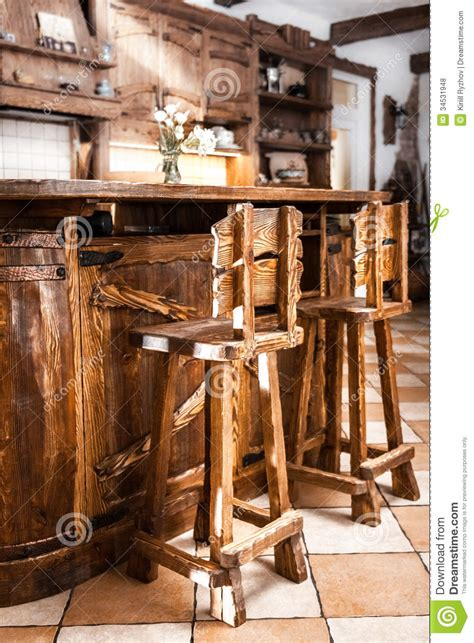 country style bar chairs two high wooden bar chairs in country style royalty free