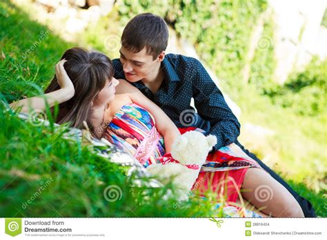 Cauple Senny happy flirting in a summer park stock images image 28816404