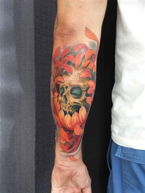 forearm colour skull  chrysanthemum tattoo chronic ink