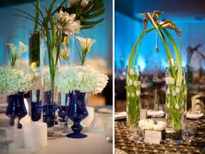 Chic white and blue wedding reception centerpieces using white
