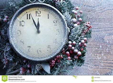 christmas clock  snow wooden background royalty