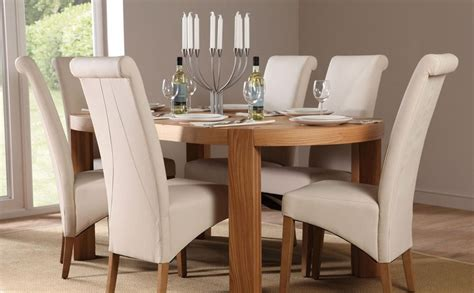 Dining Room Chair And Table Sets by Oval Dining Table And Chairs Marceladick