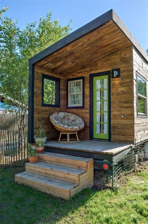 woman bypasses mortgage payments builds  tiny house