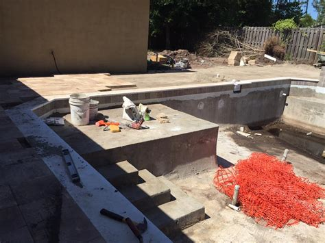 palm coast b section new pool spa combo with travertine coping finished in palm