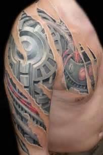 Chest and arm biomechanical tattoo design of tattoosdesign of