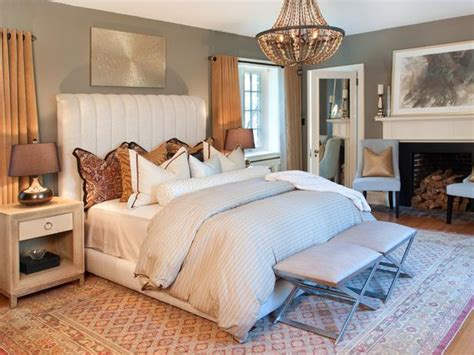 transitional style bedroom in brown with blue a bold create a regal feel in a luxurious white and gold bedroom