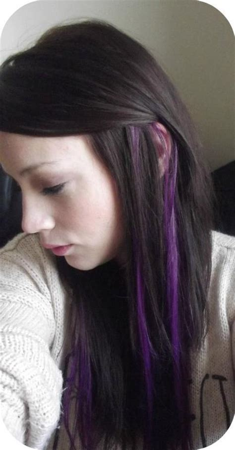 hightlight in stip of front black hair with purple peekaboo highlights