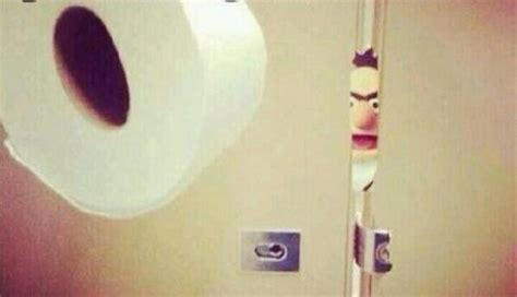 peep through the bathroom door 21 awkward bathroom moments we ve all experienced
