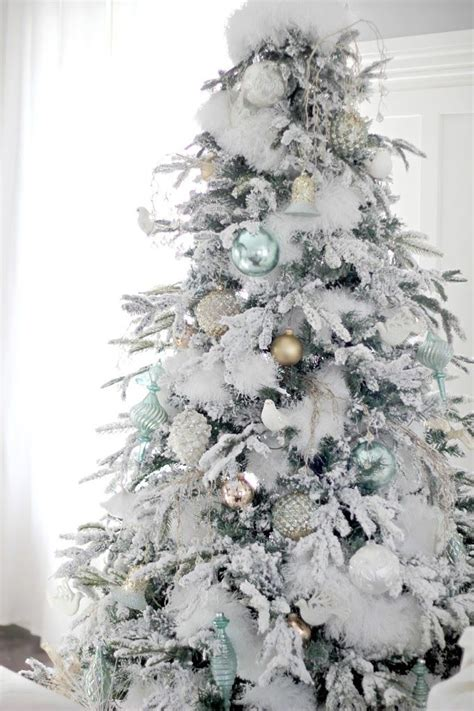 1000 ideas about flocked christmas trees on pinterest