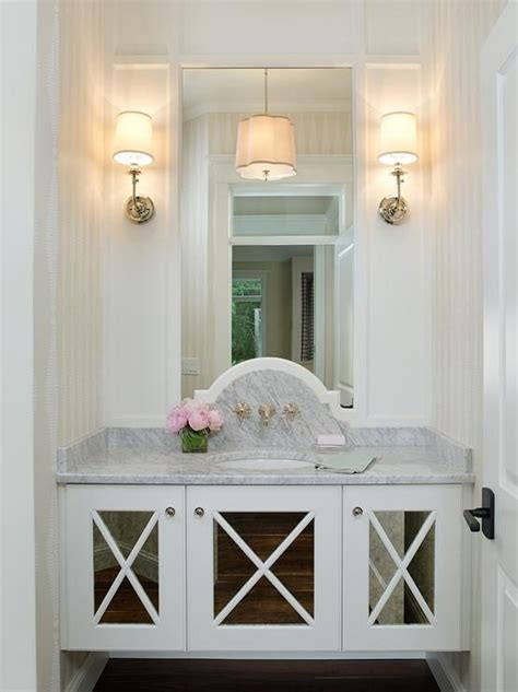 glam powder room boasts  floating vanity fitted