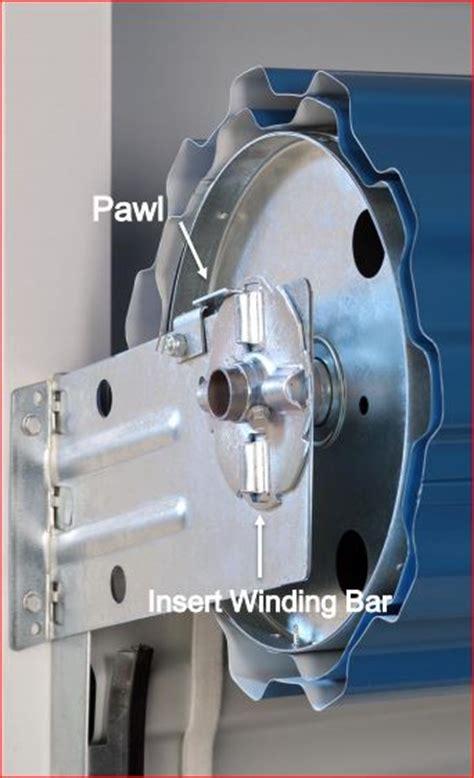 Adjust Garage Door Tension How To Set The Tension Device Adjustment On A Roll Up Door