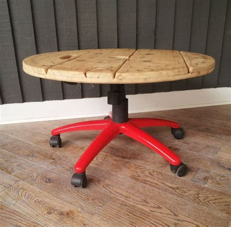 wooden coffee table from cable drum and by