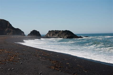 beach with black sand 10 black sand beaches that will blow your mind