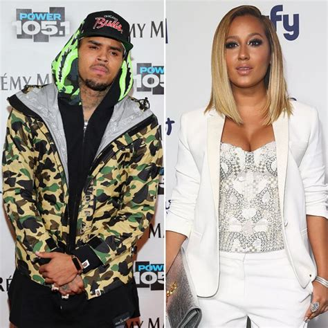 chris brown adrienne bailon feud fans freak out on