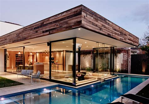 home design trends vol 3 nr 7 2015 a sunken lounge room surrounded by a pool is the centerpiece of this home renovation