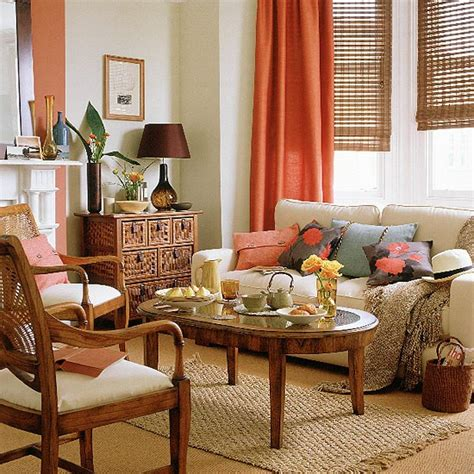 neutral living room with sofa wooden furniture and orange curtains housetohome co uk