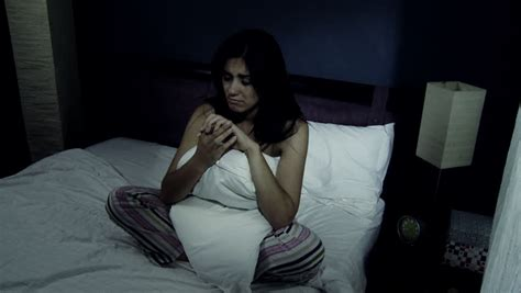 crying in bed desperate woman with problems crying in bed looking engament ring stock footage video