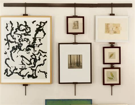 how to hang artwork pictures and wall decor at the hanging systems master framing