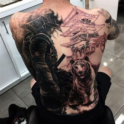 tattoo parlor qatar black ink samurai with tiger tattoo on man full back